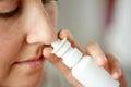 Close up of sick woman using nasal spray Royalty Free Stock Photo