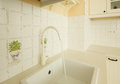 Close up sink running water white kitchen antique rustique style Royalty Free Stock Photos