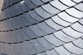 Close up of slate roof tiles background.