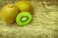 Close up slice of fresh kiwi fruit on old wood background. Royalty Free Stock Photo