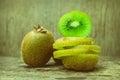 Close up slice of fresh kiwi fruit on old wood background. Royalty Free Stock Photo