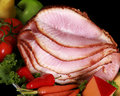 Close up of a sliced ham on a black background Royalty Free Stock Photo