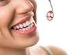 Close-up of smile patient with healthy tooth with dental mirror Royalty Free Stock Photo