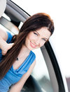 Close up of smiley woman in the white car Royalty Free Stock Photos