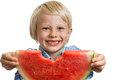 Close up of smiling boy holding water melon a shot a cute out a nibbled isolated on white Royalty Free Stock Images