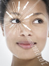 Close up of smiling businesswoman with binary digits and arrow signs moving towards her eye against white background Royalty Free Stock Photo