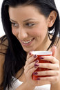 Close up of smiling female holding coffee mug Stock Photos