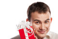 Close-up  smiling man holding gift isolated Royalty Free Stock Photography
