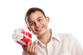 Close up smiling man holding gift isolated portrait of on white background Stock Photos
