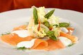 Close up of smoked salmon salad with green asparagus Stock Image
