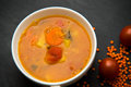 Close up on soup with tomato, lentil and potato, rustical backgr Royalty Free Stock Photo
