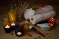 Close-up. Spa still life. Sea salt bath, massage oil, candles, flowers and towels. Royalty Free Stock Photo