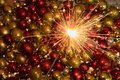 Close up sparkler firework light up in front of an amazing new year decoration Royalty Free Stock Photo