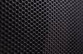 Close up of speaker black metal grille Royalty Free Stock Photo