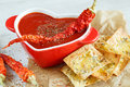 Close-up of a spicy tomato soup with chips Royalty Free Stock Photo
