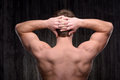 Close up of sporty man demonstrating back muscles Royalty Free Stock Photo