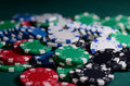 Close-up Stack of casino chips on a green background. Poker theme Royalty Free Stock Photo
