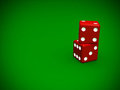 Close up stack of red dices on green background Royalty Free Stock Images