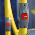 Close up of a stop button on a passenger bus fitted to grab rail Royalty Free Stock Image
