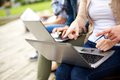 Close up of students or teenagers with laptop Royalty Free Stock Photo