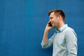 Close-up of a successful young business man talking on cell phone Royalty Free Stock Photo