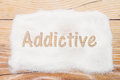 Close-up of sugar with text Addictive on weathered wood backgrou Royalty Free Stock Photo