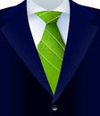 Close up of suit with green tie representing a natural job in defense a environment Stock Photography