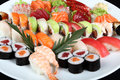Close-up sushi and sashimi mixed on round white plate Royalty Free Stock Photo