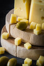 Close up of Swedish hard yellow cheese with holes chopped on wooden cut Royalty Free Stock Photo