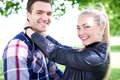 Close up sweet young couple smiling at the camera white park holding each other and Stock Photography