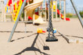 Close up of swing on playground outdoors Royalty Free Stock Photo