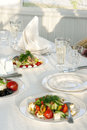 Close up table set service with silverware and glass stemware at restaurant before party Stock Images