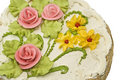 Close-up of tasty cake with cream, pink roses Royalty Free Stock Images
