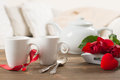 Close up of teacups with red roses for valentine s day Royalty Free Stock Image