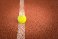 Close up of tennis ball on clay court tennis ball Royalty Free Stock Photo