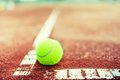 Close up of tennis ball on the court green clay Royalty Free Stock Images