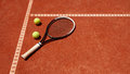 Close up of tennis balls and racket on dross Royalty Free Stock Photo