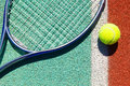 Close up of tennis racquet and ball on the clay court Royalty Free Stock Photo