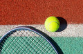 Close up of tennis racquet and ball on the tennis court clay Royalty Free Stock Photography