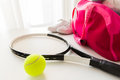 Close up of tennis stuff and female sports bag Royalty Free Stock Photo