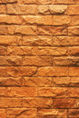 Close up texture of yellow brown rough brick wall for background Stock Photo