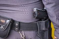 Close up of Thailand's police pistol, Policeman's equipment belt Royalty Free Stock Photo