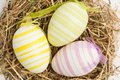 Close up three easter eggs straw Royalty Free Stock Photos
