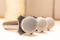 Close-up three microphone heads with warm fall color and blurred Royalty Free Stock Photo