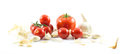 Close up of three types of tomatoes - big red, long and cherry and garlic on a white background Royalty Free Stock Photo