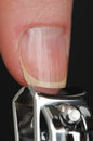 Close up thumb nail being cut nail clipper Royalty Free Stock Photos