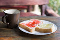 Close up toast with jam and coffee on wooden table Royalty Free Stock Photo