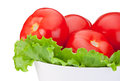 Close up tomatoes with green salad leaf in bowl fresh isolated on white background Royalty Free Stock Photography