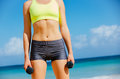 Close up of torso of fitness woman barbells holding Royalty Free Stock Image