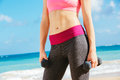 Close up of torso of fitness woman holding barbells Royalty Free Stock Photo